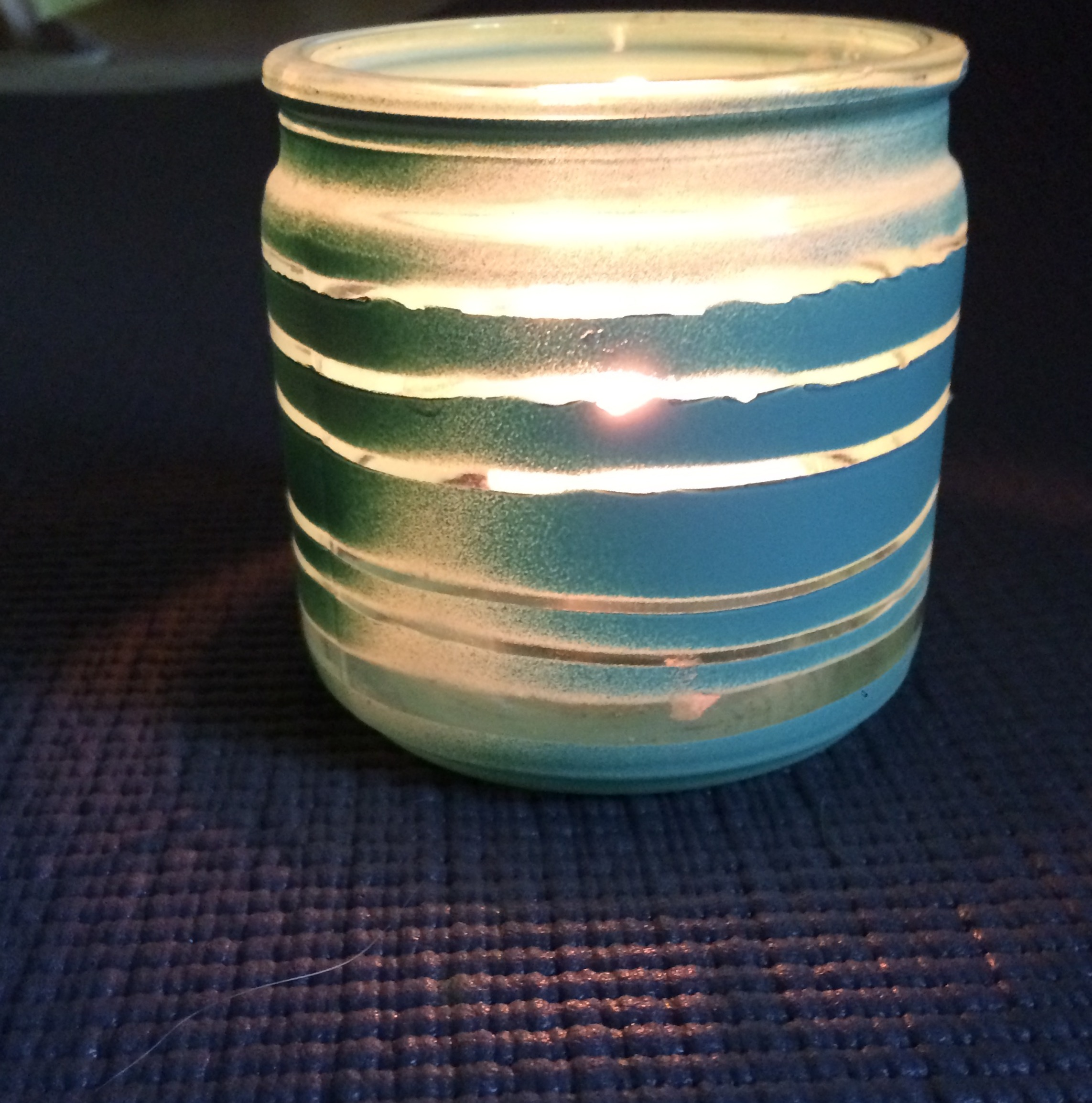 Finished and lit upcycled tealight candle holder