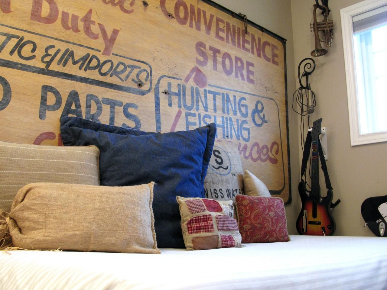 Old-sign-headboard-and-different-pillows