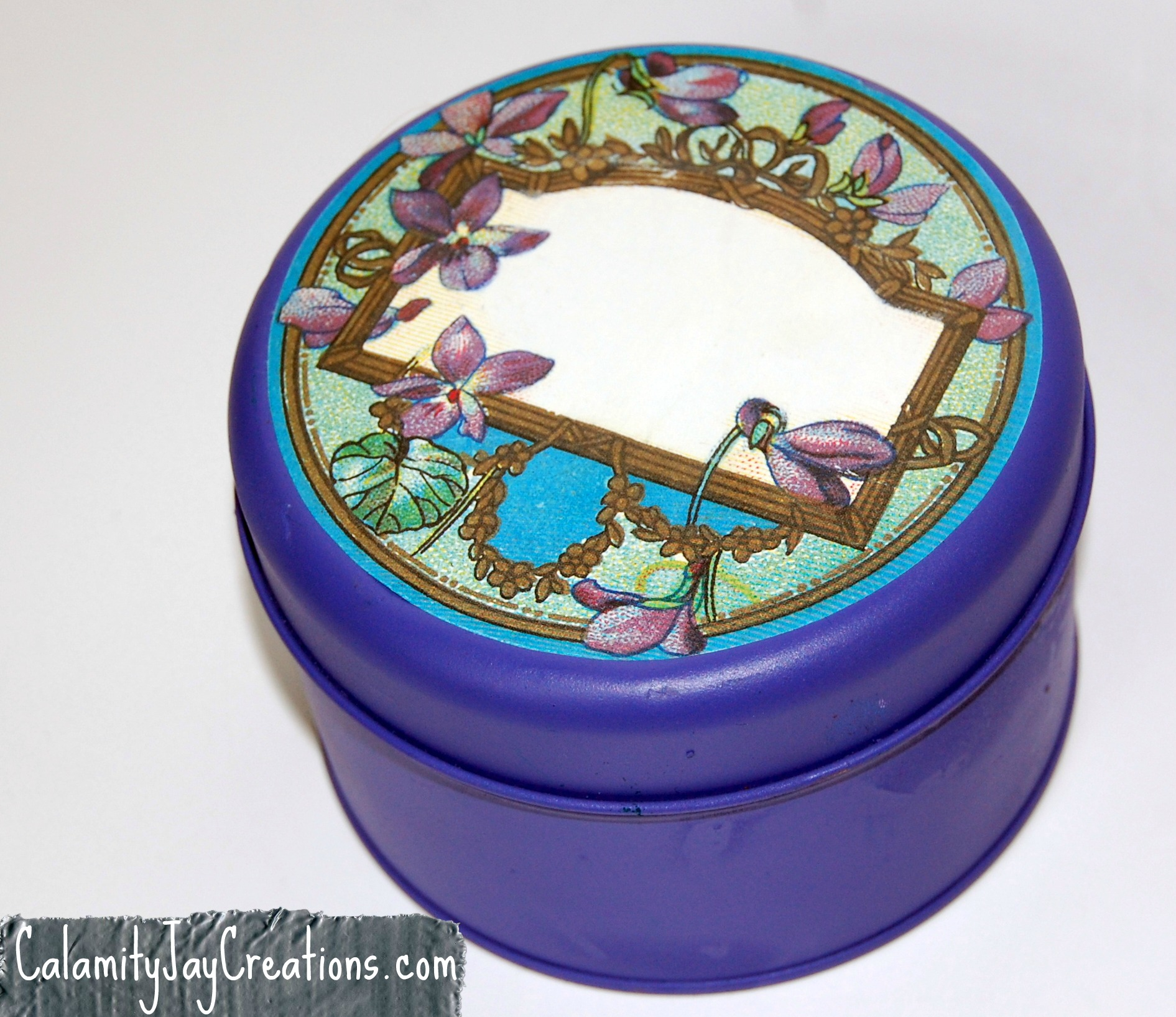 The bright purple $1 dollar general tin upcycled redo recyle reuse floral sticker indigo flowers width=