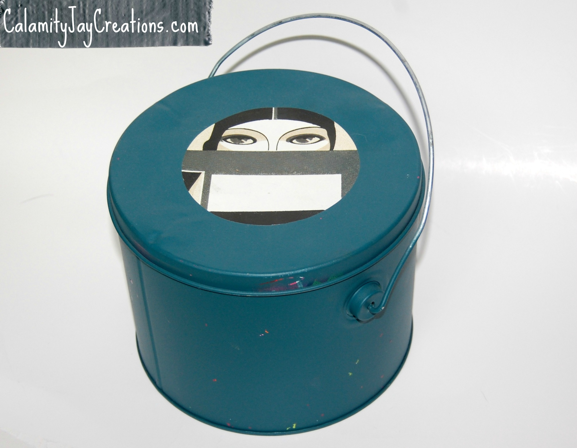 Finished teal bucket with eyes sticker book plate